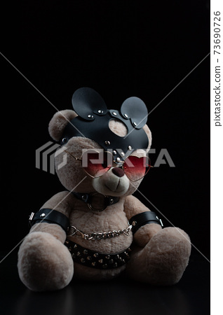 toy bear with glasses in the form of a heart in a leather belt accessory for BDSM games gift for Valentine's day 73690726