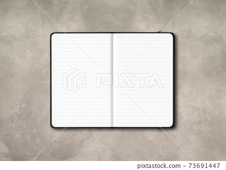 Black open lined notebook isolated on concrete background 73691447