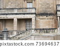 Medieval Maltese Architecture. View Of A Building Facade With Tall Windows And Balconies 73694637