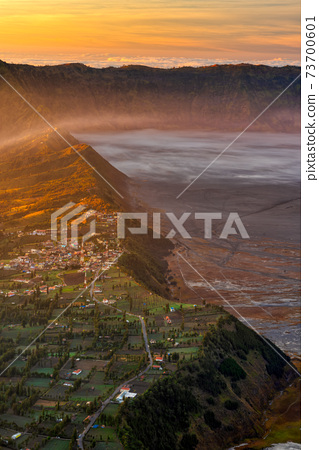 Sunrise at Cemoro Lawang village at mount Bromo volcano in Bromo tengger semeru national park, East Java, Indonesia 73700601
