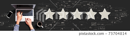 Rating star concept with person using laptop 73704814