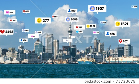 Social media icons fly over city downtown showing people engagement connection 73723679