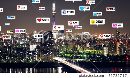 Social media icons fly over city downtown showing people engagement connection 73723717