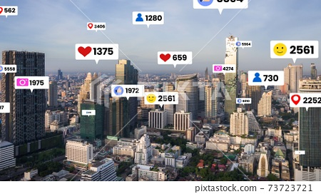 Social media icons fly over city downtown showing people engagement connection 73723721