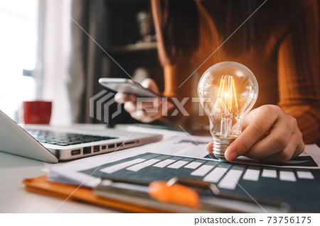 business hand showing creative business strategy with light bulb as concept. 73756175
