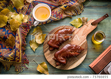 Braised pig's trotter and pig hand scene on wooden plate 73760855