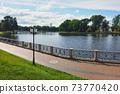Pedestrian sidewalk around city lake embankment 73770420