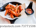 Close up of Thai Salt Fried Chicken Wing with Chilli Sause 73771506
