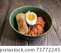 Fried dumplings and noodles with soft-boiled egg 73772245