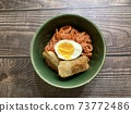 Fried dumplings and noodles with egg 73772486