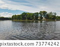 Calm water surface of city pond in Kaliningrad 73774242