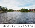 Calm water surface of city lake in Kaliningrad 73774243