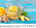 Ginger tea with lemon and peppermint 73774477