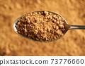 Panela or rapadura - healthy sweetener made by evaporating sugercane juice, top view 73776660