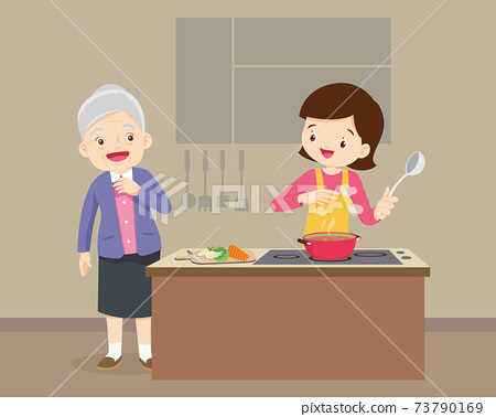 elderly woman looking to woman cooking in kitchen 73790169