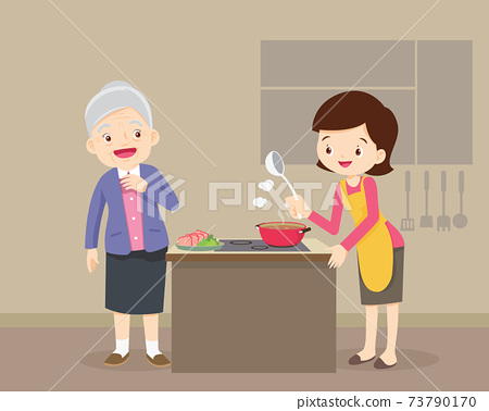 elderly woman looking to lovely woman cooking in kitchen 73790170