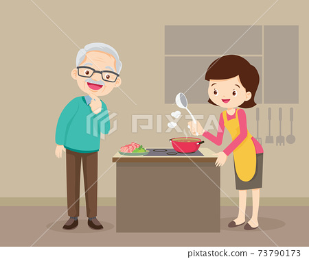 elderly man looking to lovely woman cooking in kitchen 73790173