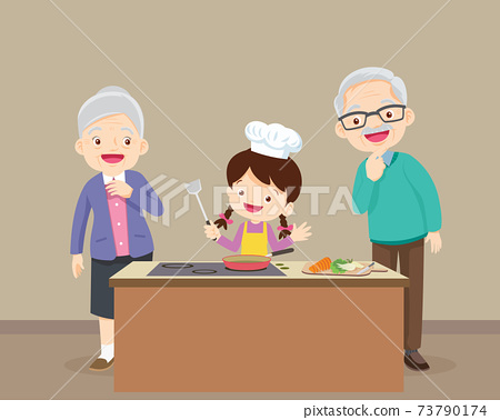 elderly happy looking at child girl cooking in kitchen 73790174