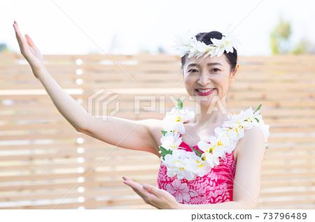 A woman making a hula dance 73796489