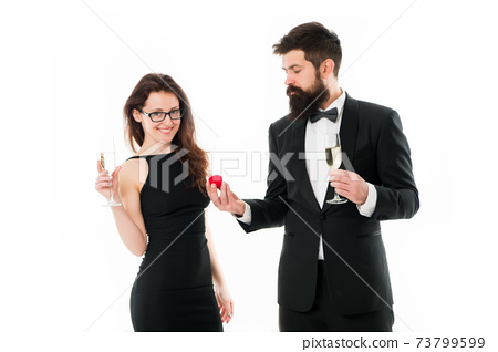 proposal of marriage. bearded man in tuxedo makes  73799599