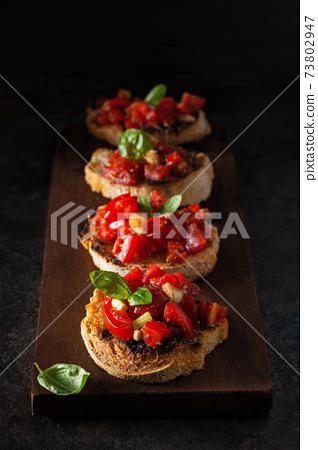 Bruschetta with tomato and basil. 73802947