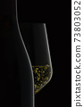 Bottle and white wine silhouette. 73803052