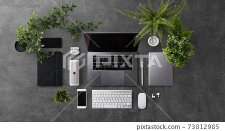 Flat lay top view office desk working space with laptop and office supplies on dark background. 73812985