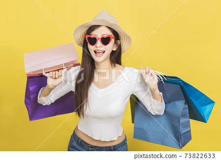 Happy Beautiful young woman with shopping bags 73822633