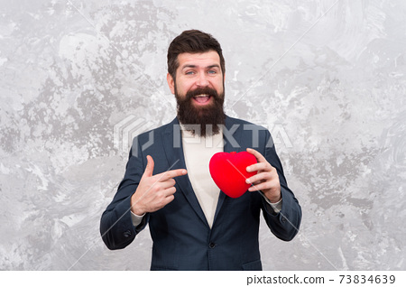 Give your heart for Valentines day. Organ donation. Bearded man  73834639