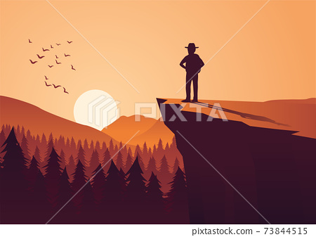 man take adventure in jungle,stand on cliff look to the sun in around with pine forest 73844515