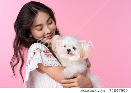 Asian woman with her dog 73847999