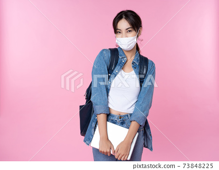 Asian college student wears face mask with laptop 73848225