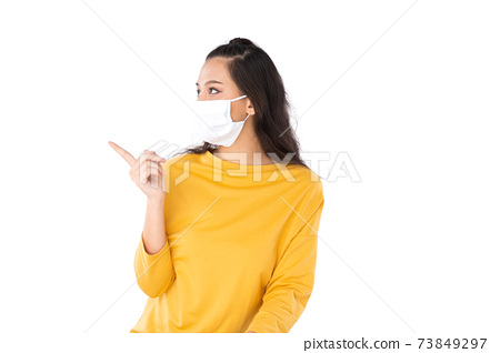 Asian woman wearing face mask 73849297