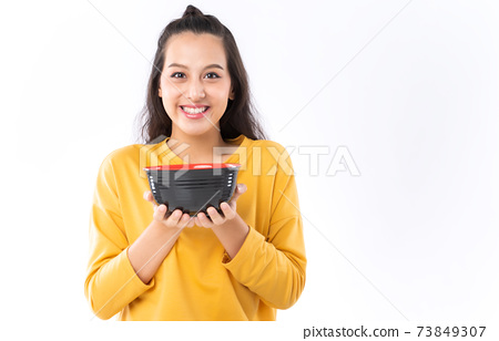 Asian woman showing bowl prepare to eat food 73849307