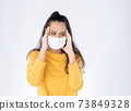 Worry Asian woman wearing hygienic mask 73849328