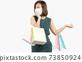 Young Asian woman holding shopping bag wear face mask 73850924