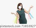Young Asian woman holding shopping bag wear face mask 73850927