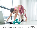 Young Asian beautiful woman training fitness at home with cat 73850955