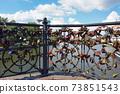 Padlocks on city bridge landmark in Kaliningrad 73851543