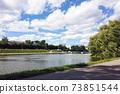 Pedestrian walkway on embankment of city pond 73851544