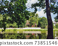 Landscape with green trees on city pond embankment 73851546