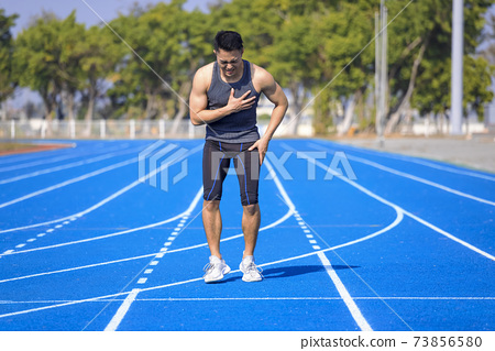 Male runner athlete chest injury and pain 73856580