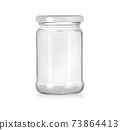 Open empty glass jar for food and canned food. 73864413