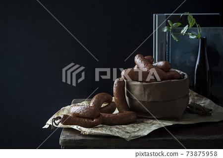 A bunch of meat sausages 73875958
