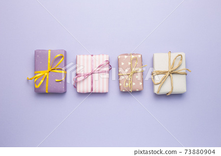 Purple gift boxes on purple background. flat lay, top view, copy space 73880904