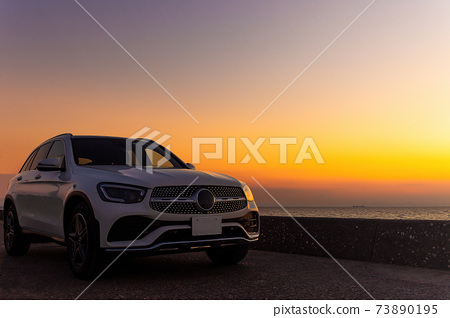 Luxury car and sunset 73890195