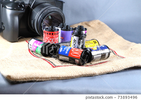Part of a film camera and an empty film cartridge and jute bag 73893496