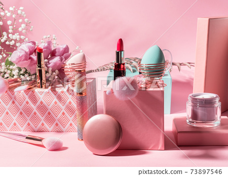 Make up tools, products on geometric podiums on pink 73897546