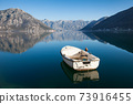 White boat is on the sea. Amazing landscape with mountains, clea 73916455