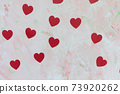 Romantic pink backround with red hearts decoration 73920262